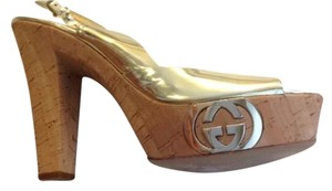 Gucci Gold Platforms
