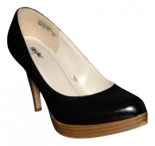 Preload https://item1.tradesy.com/images/mossimo-supply-co-black-leather-with-faux-wood-grain-platform-pumps-size-us-75-regular-m-b-15940-0-0.jpg?width=440&height=440