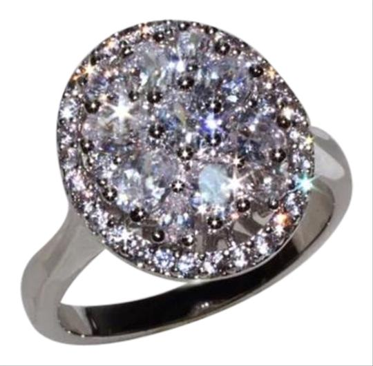 Preload https://img-static.tradesy.com/item/15944062/silver-new-mega-bling-and-sparkly-white-topaz-and-cz-6-ring-0-1-540-540.jpg