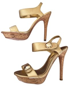 bebe Stilettos Gold Hardware Leather Cork Gold Platform Sandals