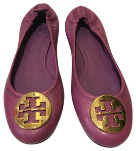 Tory Burch Purple with a gold symbol Flats