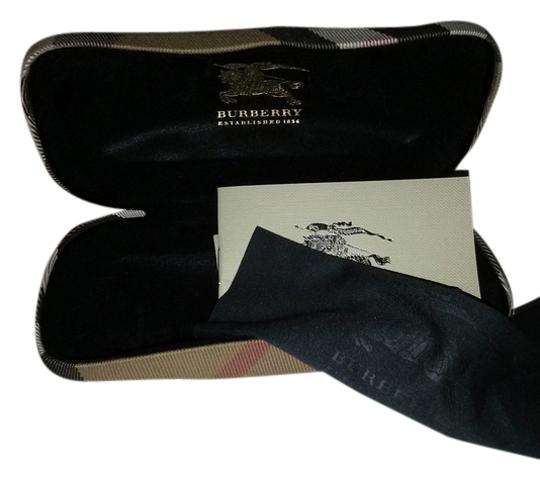 Burberry one Burberry sunglasses case and one Coach!
