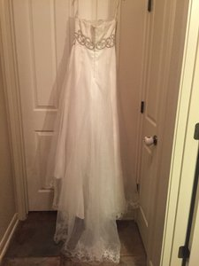 St. Pucchi Style 220 - Discontinued Style Wedding Dress
