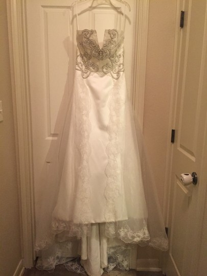 St. Pucchi Ivory Has Lace Trim and Rhinestone Detail. Style 220 - Discontinued Style Vintage Wedding Dress Size 6 (S)