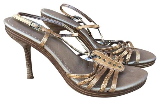 Preload https://img-static.tradesy.com/item/15965272/aldo-metallic-gold-bronze-strappy-sandals-size-us-75-regular-m-b-0-1-540-540.jpg