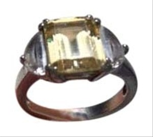 CRISLU Anniversary ring with faux canary diamond center with clear faux diamonds flanking