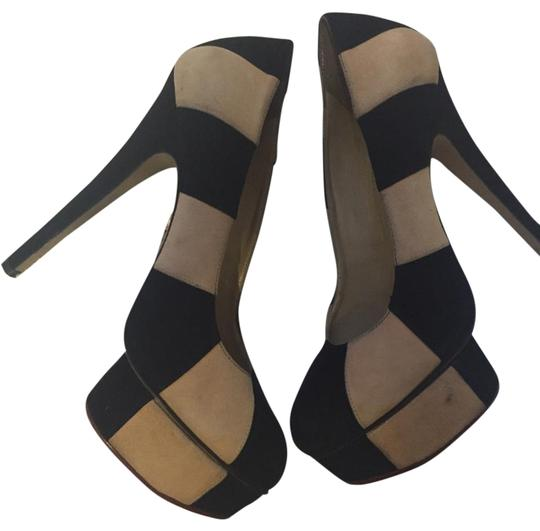 Preload https://item1.tradesy.com/images/charlotte-olympia-black-and-white-striped-pumps-size-us-75-regular-m-b-15971770-0-1.jpg?width=440&height=440