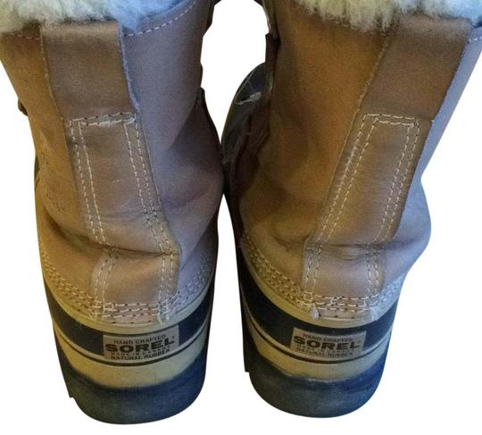 Preload https://img-static.tradesy.com/item/15974785/sorel-buff-caribou-bootsbooties-size-us-7-wide-c-d-0-1-540-540.jpg