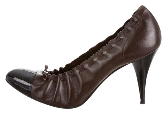 Preload https://item2.tradesy.com/images/chanel-brown-and-black-pumps-size-us-85-regular-m-b-15978631-0-1.jpg?width=440&height=440