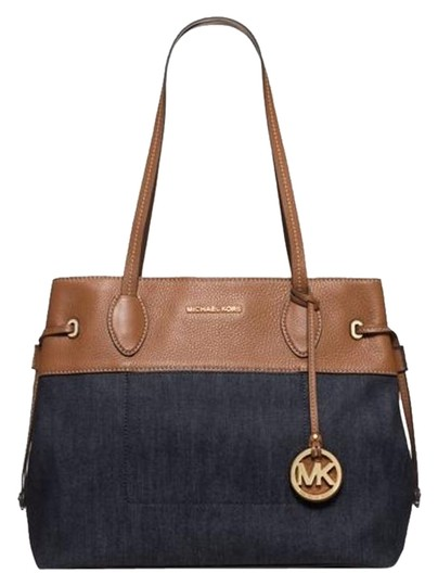Preload https://img-static.tradesy.com/item/15980209/michael-kors-marina-large-drawstring-dark-denim-tote-0-1-540-540.jpg