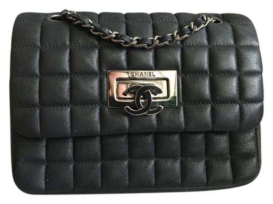 Preload https://item5.tradesy.com/images/chanel-classic-mini-square-flap-black-calfskin-leather-shoulder-bag-15982699-0-1.jpg?width=440&height=440