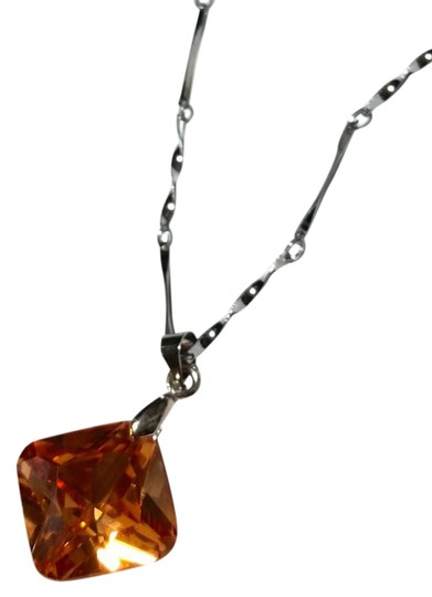 Preload https://img-static.tradesy.com/item/15986095/silver-orange-new-crystal-pendant-tone-a211-necklace-0-3-540-540.jpg