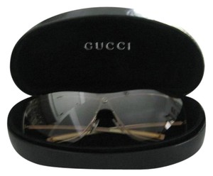 Gucci Gucci Unisex sunglasses with brown gradient lense and bronze frame.