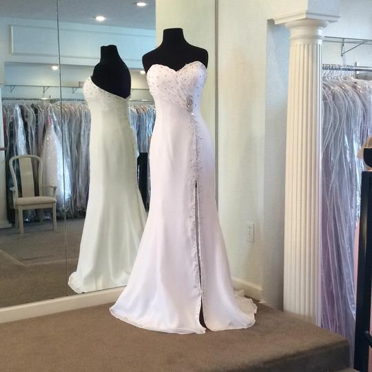 Preload https://item4.tradesy.com/images/showtime-collection-white-chiffon-destination-wedding-dress-size-8-m-15986353-0-0.jpg?width=440&height=440