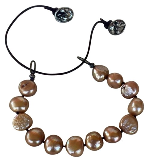 Preload https://img-static.tradesy.com/item/15990745/anthropologie-peach-brown-and-silver-gold-pearl-leather-bracelet-0-1-540-540.jpg