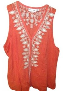 St. John Top orange with printed flowers on the front