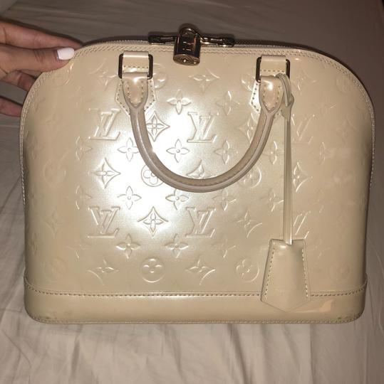 Preload https://img-static.tradesy.com/item/16003966/louis-vuitton-alma-vernice-pm-d-amour-patent-satchel-0-2-540-540.jpg