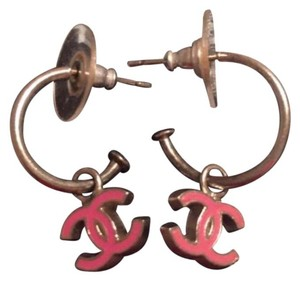Chanel 100% Authentic Chanel dangle earrings with pink double Cs.