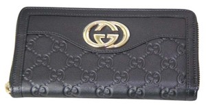 Gucci Gucci GG Guccissima leather zip around wallet
