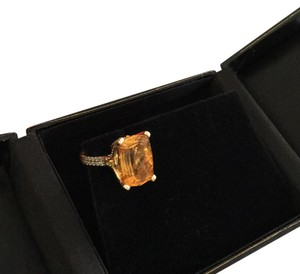Yellow Topza ring set in yellow gold with white diamonds