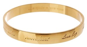 Kate Spade gold plated love bug engraved bangle