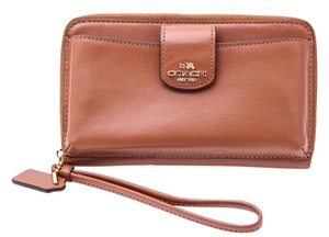 Coach Legacy Pebbled Leather Phone Pocket Wristlet in Camel
