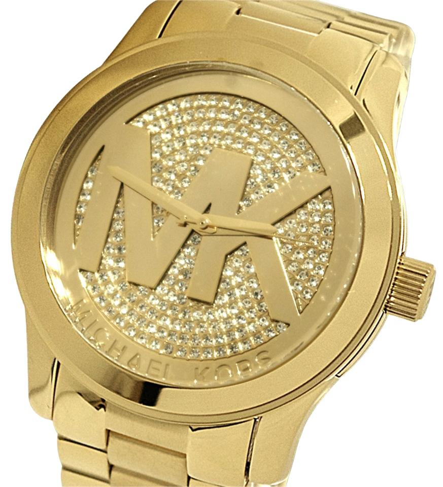 ee2e09cf11d6 Michael Kors Gold Mk5706 Woman Runway Watch - Tradesy