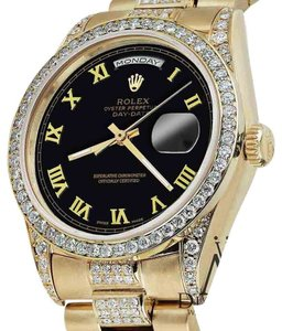Rolex Rolex Presidential 36MM Day Date Black Roman Diamond 18 KT Yellow Gold