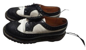 Dr. Martens Black and White Flats