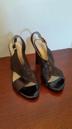 Madeline Stuart Metallic Patent Leather Crossover Size 7 Never Worn Black Pumps