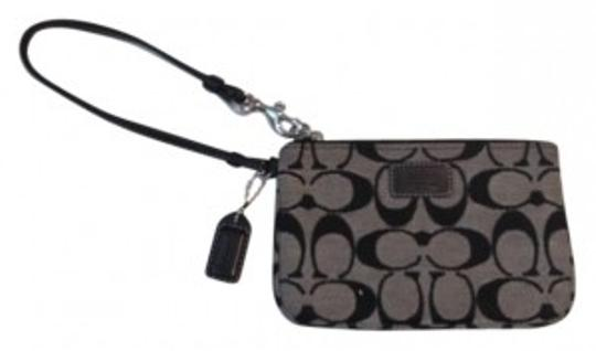 Preload https://item4.tradesy.com/images/coach-black-and-grey-canvas-with-leather-trim-wristlet-160723-0-0.jpg?width=440&height=440