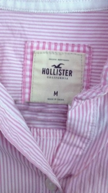 Preload https://item3.tradesy.com/images/hollister-light-pink-button-down-top-size-8-m-160732-0-1.jpg?width=400&height=650