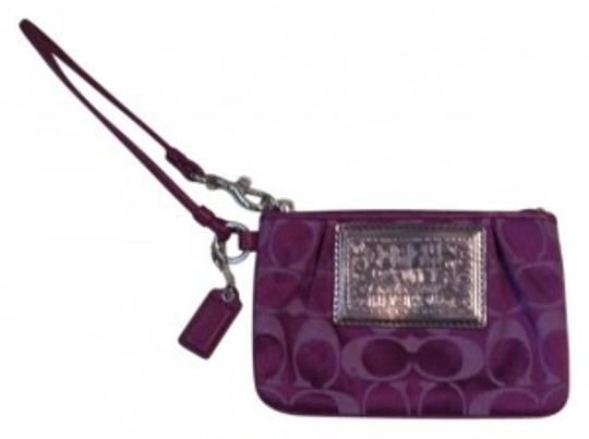 Preload https://item4.tradesy.com/images/coach-purple-canvas-with-leather-trim-wristlet-160768-0-0.jpg?width=440&height=440