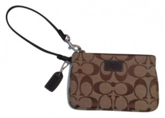 Preload https://item4.tradesy.com/images/coach-brown-canvas-with-leather-trim-wristlet-160783-0-0.jpg?width=440&height=440