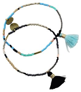 Bluma Project Delicate beaded stretch bracelets with a fun tassel.