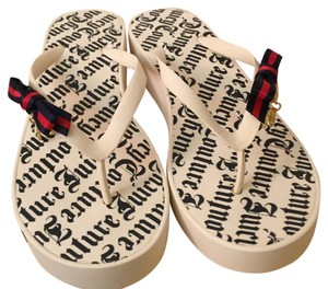 Juicy Couture Off white with Navy print. Sandals