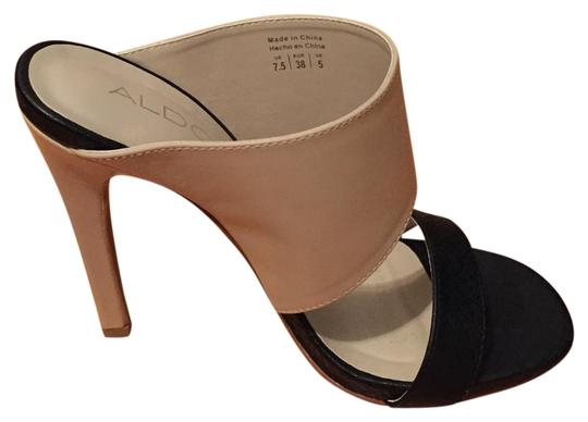 Preload https://item1.tradesy.com/images/aldo-black-and-nude-new-two-tone-slip-on-pumps-size-us-75-regular-m-b-16102630-0-1.jpg?width=440&height=440