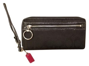 Coach Black zip around fabric wallet
