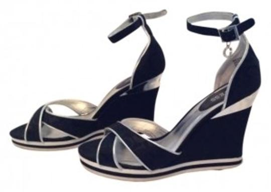 Preload https://img-static.tradesy.com/item/161208/guess-black-sandals-with-silver-trim-wedges-size-us-85-0-0-540-540.jpg