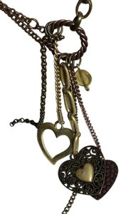Creative Designs by appealing lady Rose Goldtoned Hearts Dangling Necklace