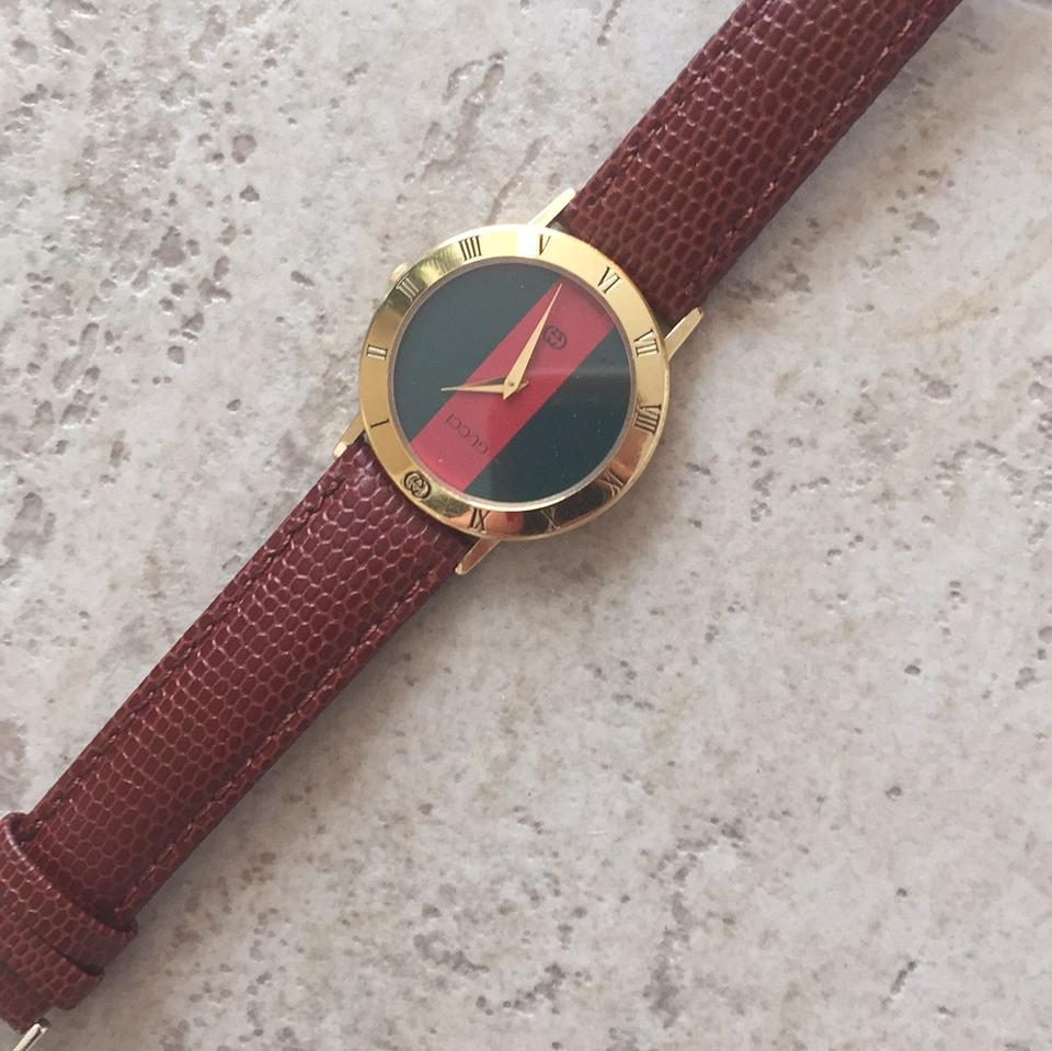 2cb6a11f40f Gucci Gold Frame Green and Red Inside 3001 M 217-753 Watch - Tradesy