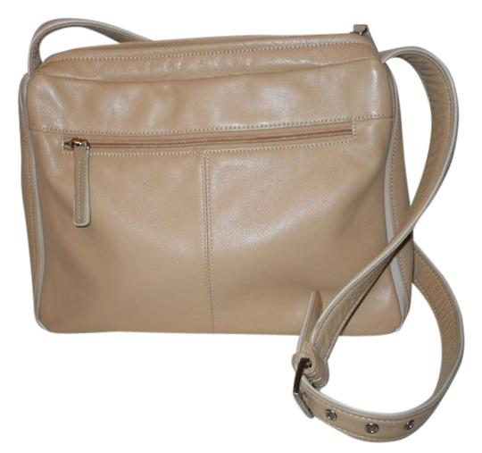 Preload https://item5.tradesy.com/images/stone-mountain-accessories-tan-leather-cross-body-bag-1617659-0-0.jpg?width=440&height=440