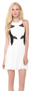 Bless'ed are the Meek short dress White & Black Mini on Tradesy