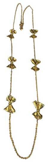 Preload https://item4.tradesy.com/images/jcrew-gold-costume-bow-necklace-1618688-0-0.jpg?width=440&height=440