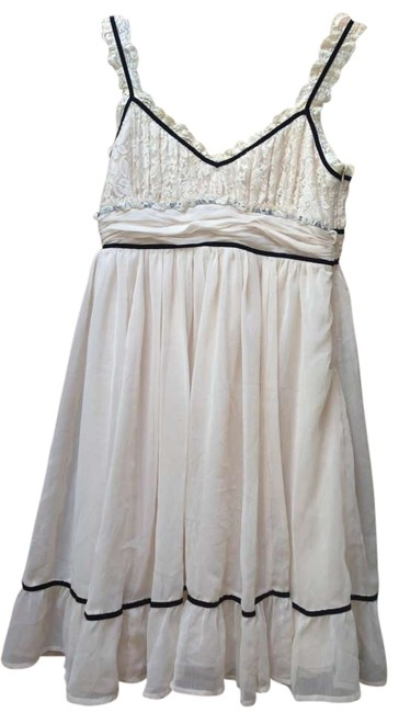 Preload https://item3.tradesy.com/images/forever-21-cream-lace-knee-length-night-out-dress-size-14-l-162197-0-0.jpg?width=400&height=650