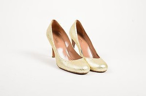 ALAÏA Alaia Tone Metallic Gold Pumps