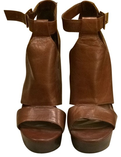 Preload https://item3.tradesy.com/images/jessica-simpson-brown-platforms-1623207-0-0.jpg?width=440&height=440