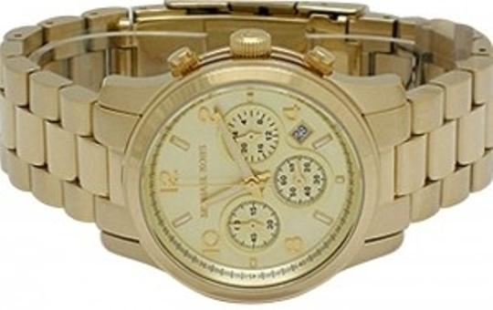 Preload https://img-static.tradesy.com/item/162353/michael-kors-gold-style-number-mk5055-watch-0-0-540-540.jpg