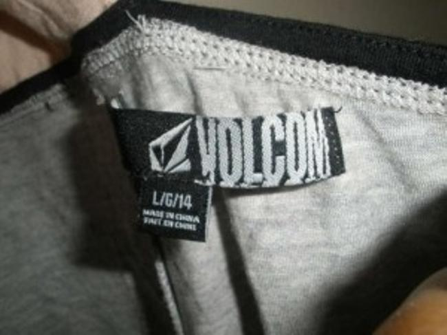 Volcom Straps Are Similar To A Bra You Can Adjust. Grey, peach pink, and black. Halter Top