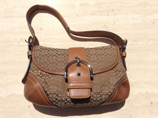 Preload https://img-static.tradesy.com/item/16266136/coach-small-brown-and-tan-hobo-bag-0-2-540-540.jpg